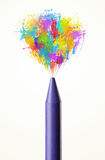 Colored paint splashes coming out. Of colored crayon Royalty Free Stock Photos