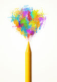 Colored paint splashes coming out of crayon Royalty Free Stock Photo