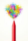 Colored paint splashes coming out of crayon. Colored paint splashes coming out of colored crayon Stock Photography