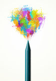 Colored paint splashes coming out of crayon. Colored paint splashes coming out of colored crayon Royalty Free Stock Photo