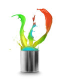 Colored paint splashing out of can Royalty Free Stock Photo