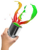 Colored paint splashing out of can Royalty Free Stock Image
