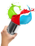 Colored paint splashing out of can Royalty Free Stock Images