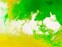 Colored paint swirling in water royalty free stock photo