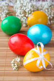 Colored painted eggs on bamboo table Stock Photo