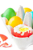 Colored painted eggs in a basket. Isolated colored painted eggs in a basket at Easter Stock Photo