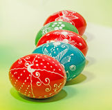 Colored painted romanian traditional Easter eggs, close up, gradient background Stock Images