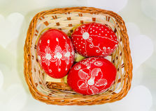 Colored painted romanian traditional Easter eggs in a rustic (vintage) basket, close up Stock Photos