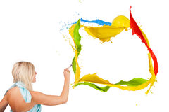 Colored painting. Beautiful paintress painting colored splashes frame, isolated on white background Stock Photo