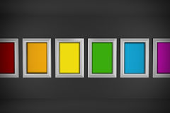 Colored paintings in minimal interior design. Multicolor canvas with white frames in minimal and dark interior design Stock Image