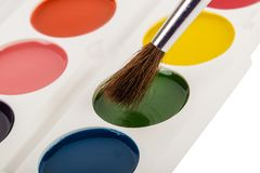Colored paints box with brush Stock Photography