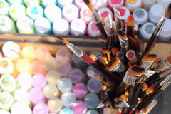 Colored paints and brushes