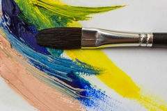 Colored paints and brushes for painting Stock Photography