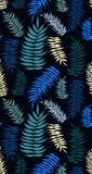 Colored palm leaves seamless pattern in turquoise tones. Tropical colored palm leaves seamless pattern on the dark background. Blue, turquoise palm leaves Stock Photo