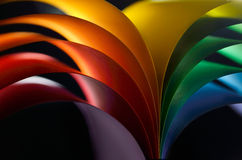 Colored paper. Rainbow colored paper on black background Royalty Free Stock Photography