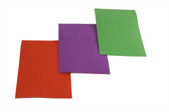 Colored Paper. Three sheets of colored paper - one red, one purple, one green - slightly overlapped Stock Image