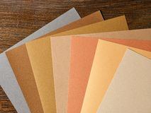 Colored paper in autumn colours Stock Images