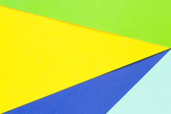 Colored papers geometry flat composition background with yellow, green and blue tones Stock Images