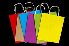 Colored paper bags on a black background