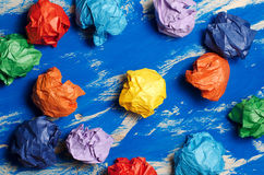 Colored paper on blue abstract background. Concept. Idea for lif Stock Photo