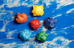 Colored paper on blue abstract background. Concept. Idea for lif Stock Photography