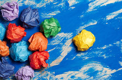 Colored paper on blue abstract background. Concept. Idea for lif Royalty Free Stock Image