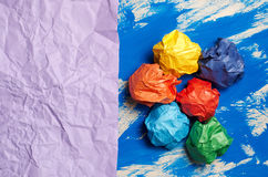 Colored paper on blue abstract background. Concept. Idea for lif Stock Image