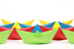 Colored paper boats. Several colored paper boats on white background royalty free stock image