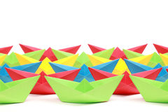 Colored paper boats. Several colored paper boats on white background stock photography
