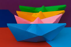 Colored paper boats on the colorful background Stock Images