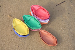 Colored paper boats on the sand Royalty Free Stock Photography