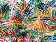 Colored paper clip background Royalty Free Stock Images