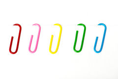 Colored paper clip. On white Stock Photography
