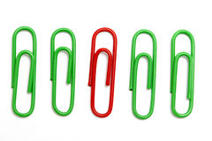 Colored paper clip. On white Royalty Free Stock Photos
