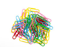 Colored paper clip. On white Stock Images