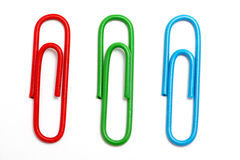 Colored paper clip. On white Stock Photos