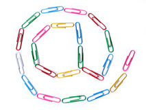 @ - at. Colored paper clips arranged in Royalty Free Stock Photography