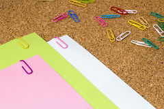 Colored paper clips. Cortical base Stock Photos
