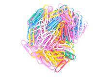 colored paper clips on a white background. School supplies. Stationery. royalty free stock photo