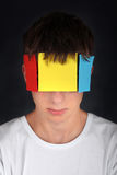 Colored Paper on Face Stock Photos
