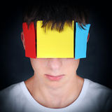 Colored Paper on the Face Stock Photography