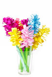 Colored paper flowers in a faceted glass Royalty Free Stock Image