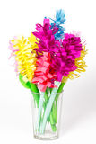 Colored Paper Flowers In A Faceted Glass