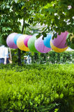 COLORED PAPER LANTERNS HANGING OUTSIDE Stock Image