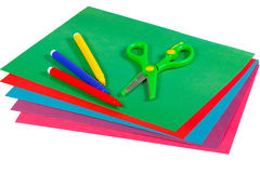 Colored paper, markers and scissors Stock Photography