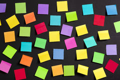 Colored paper notes. Background image of multicolor notes on a black board Stock Photography