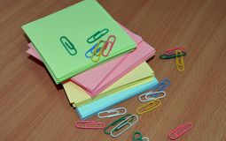 Colored paper for notes paper clips for documents business Stock Photos