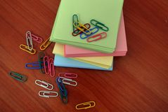 Colored paper for notes paper clips for documents business Stock Images