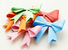 Colored paper origami bows for holiday Royalty Free Stock Image