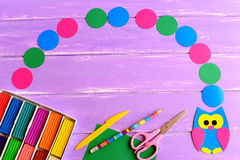 Colored paper owl crafts, modeling clay set, green paper sheet, scissors, pencil. Empty paper circles for text Back to school Royalty Free Stock Image